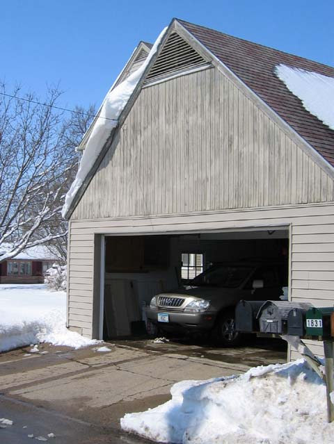 Snowy overhang on the garage